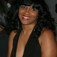 Carlita Hodges Mingle City Profile Pic wearing human hair weave, or is that a wig?