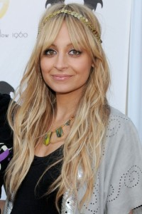 Celebrity Styles for Long Hair Weaves: Nicole Richie Uses a Bold Headband to Create a Unique Look for Her Long Hair