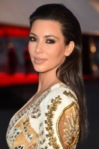 Celebrity Styles for Long Hair Weaves: Kim Kardashian Wearing Her Hair Straight and Slicked Back.
