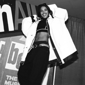 Aaliyah was very well known for her flat tummy. Here she shows it off, wearing all black and white.
